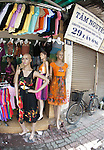 Hanoi, Vietnam, Mannequins stand outside a dress shop in the Old Quarter area of the city. photo taken July 2008.