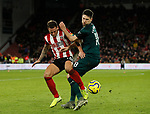 Billy Sharp of Sheffield Utd and Federico Fernandez of Newcastle United during the Premier League match at Bramall Lane, Sheffield. Picture date: 5th December 2019. Picture credit should read: Simon Bellis/Sportimage