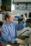 Chemistry lab technician checks sample