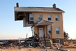 The house at 705 Front Street in Union Beach, New Jersey stands with half of it destroyed by Super Storm Sandy.  Photo By Bill Denver