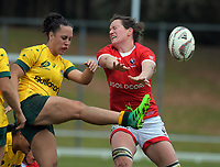 Fenella Hake (Australia) clears under pressure from Jacxey Grusnick during the 2017 International Women's Rugby Series rugby match between Canada and Australia Wallaroos at Smallbone Park in Rotorua, New Zealand on Saturday, 17 June 2017. Photo: Dave Lintott / lintottphoto.co.nz