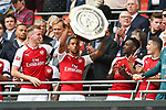 Theo Walcott of Arsenal lifts the Shield after the The FA Community Shield match at Wembley Stadium, London. Picture date 6th August 2017. Picture credit should read: Charlie Forgham-Bailey/Sportimage