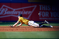 Michigan Wolverines third baseman Jimmy Kerr (15) makes a diving attempt at a base hit down the line during a game against Army West Point on February 17, 2018 at Tradition Field in St. Lucie, Florida.  Army defeated Michigan 4-3.  (Mike Janes/Four Seam Images)