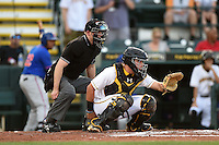 Home plate umpire Ben Levin and Bradenton Marauders catcher Reese McGuire (7) during a game against the St. Lucie Mets on April 11, 2015 at McKechnie Field in Bradenton, Florida.  St. Lucie defeated Bradenton 3-2.  (Mike Janes/Four Seam Images)