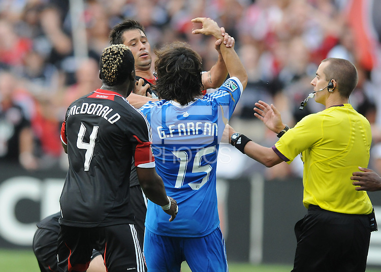 D.C. United midfielder Branko Boskovic (8) gets  into a fight with Philadelphia Union defender Gabriel Farfan (15) D.C. United tied The Philadelphia Union 1-1 at RFK Stadium, Saturday August 19, 2012.