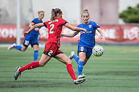 Seattle, WA - Saturday Aug. 27, 2016: Kim Little, Katherine Reynolds during a regular season National Women's Soccer League (NWSL) match between the Seattle Reign FC and the Portland Thorns FC at Memorial Stadium.