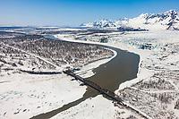 The derelict and historic Million dollar bridge crosses the Copper river in the Copper River Delta, southcentral, Alaska.