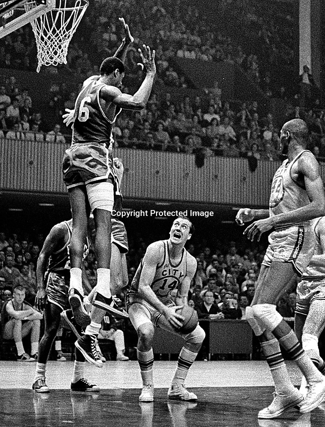 San Francisco Warriors Tom Meschery guarded by Boston Celtics Bill Russell...NBA game played at the Civic Auditorium in San Francisco(1967 photo/Ron <br />