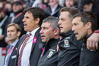 Wales manager Chris Coleman (far left) and his staff sing the national anthem ahead of during the FIFA World Cup Qualifier match between Wales and Georgia at the Cardiff City Stadium, Cardiff, Wales on 9 October 2016. Photo by Mark  Hawkins / PRiME Media Images.