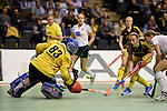 Berlin, Germany, January 31: Fenja Poppe #12 of Harvestehuder THC in action during the 1. Bundesliga Damen Hallensaison 2014/15 semi-final hockey match between HTC Uhlenhorst Muehlheim (white/green) and Harvestehuder THC (black/yellow) on January 31, 2015 at the Final Four tournament at Max-Schmeling-Halle in Berlin, Germany. Final score 6-5 after penalties (3-1, 3-3, 3-3, 3-3). (Photo by Dirk Markgraf / www.265-images.com) *** Local caption *** Lena Grabowski #83 of HTC Uhlenhorst Muehlheim, Fenja Poppe #12 of Harvestehuder THC