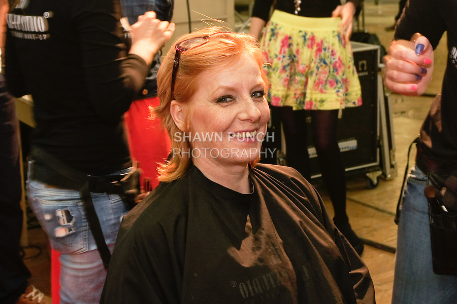 Fashion desgner Lea Fekete, gets hair and makup styled backstage before the Factory Fashion Show 2012, organized by Ina Budovksa in Trencin Slovakia, May 3, 2012.