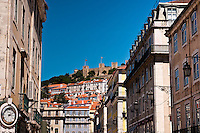 Castle of São Jorge (Castelo de São Jorge), seen from downtown Lisbon (Praca D. Pedro IV - Rossio)..The castle, dating from medieval times, stands atop the highest hill in central Lisbon..The S. Jorge Castle was conquered from moorish occupation in 1147 by D. Afonso Henriques, the first portuguese King, in what is known as the Siege of Lisbon..Since then, it has been the home of many of the following portuguese kings. After a period of severe neglect (and partial destruction in the 1755 earthquake) it has been restored and is today one of the major touristic attractions of the Portuguese capital.