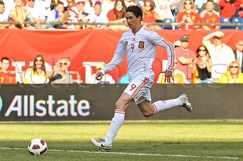 04.06.2011. Spain forward Fernando Torres (9) manages to get thru the defense untouched to score during the Spain game against the USA at Gillette Stadium in Foxborough, MA