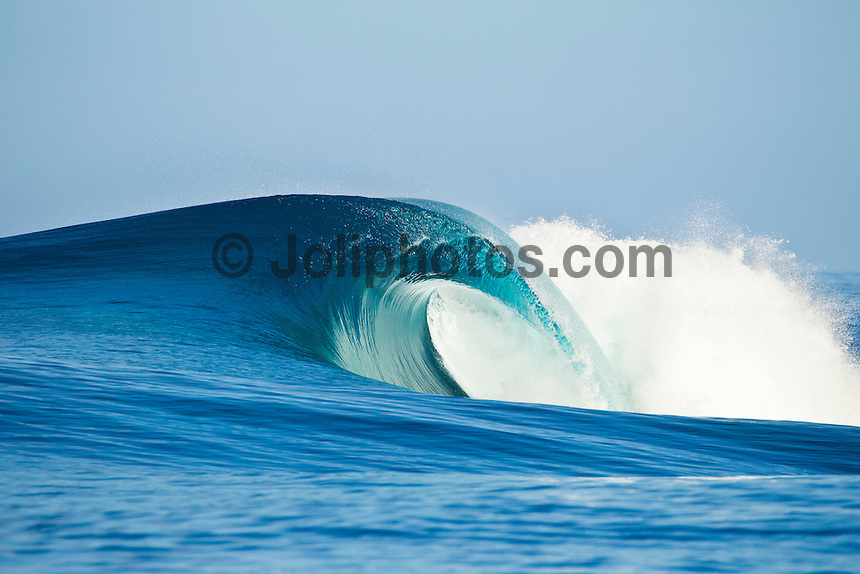Teahupoo, Tahiti Iti, French Polynesia. Sunday August 21 2011. Empty wave. A mix of south west and west swell in the 4' range was hitting the main reef at Teahupoo today. Photo: joliphotos.com
