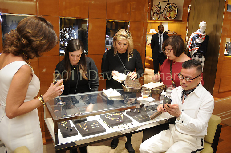 Guests shop at the America's Cup Event at the Louis Vuitton Store in the Houston Galleria Thursday Aprl 06, 2017.(Dave Rossman Photo)