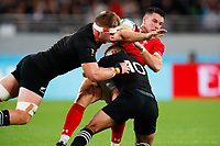 1st November 2019, Tokyo, Japan;   Sam Cane and Richie Mo'unga (NZL) with a heavy challenge on Owen Watkin (WAL);  2019 Rugby World Cup 3rd place match between New Zealand 40-17 Wales at Tokyo Stadium in Tokyo, Japan.  - Editorial Use
