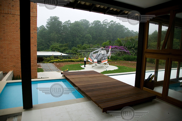 Private helicopter and helipad at a businessman's home on the outskirts of Sao Paulo.