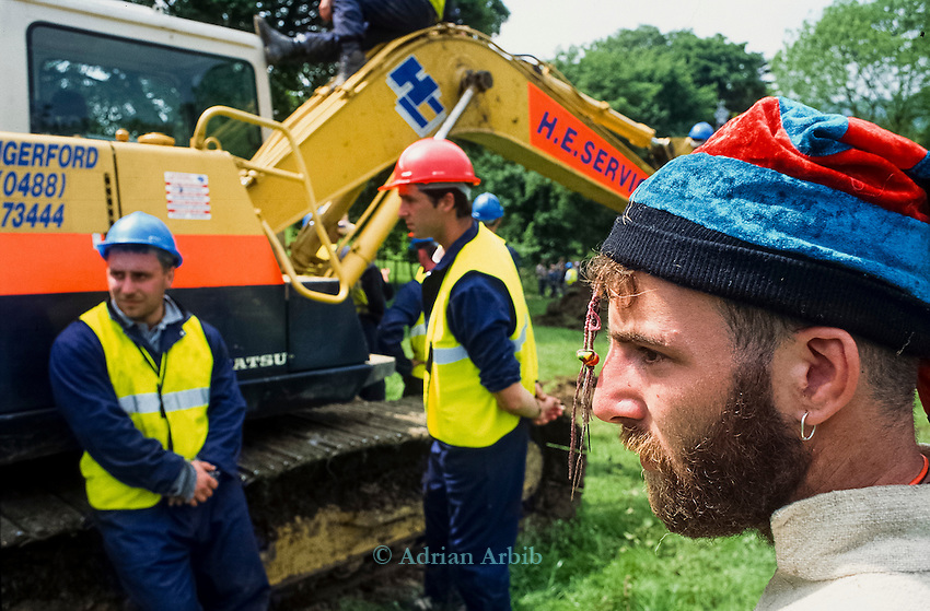 Security guards try to prevent  protesters from occupying  earth moving machinery<br /> Solsbury Hill road protest.