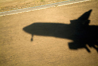 Shadow of an airplane taking off.