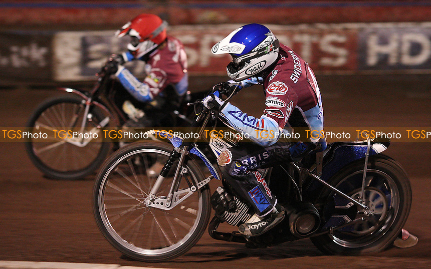 Heat 9: Piotr Swiderski (blue) and Adam Shields (red) on their way to a 5-1 heat win - Lakeside Hammers vs Birmingham Brummies, Elite League Speedway at the Arena Essex Raceway, Purfleet - 29/04/11 - MANDATORY CREDIT: Rob Newell/TGSPHOTO - Self billing applies where appropriate - 0845 094 6026 - contact@tgsphoto.co.uk - NO UNPAID USE.