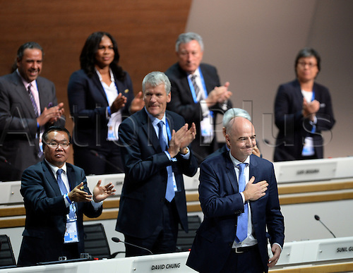 26.02.2016. Zurich, Switzerland.  Swiss Gianni Infantino (front) salutes the audience after he was elected FIFA president in the second round of voting at the Extraordinary FIFA Congress 2016 at the Hallenstadion in Zurich, Switzerland, 26 February 2016. The Extraordinary FIFA Congress is being held in order to vote on the proposals for amendments to the FIFA Statutes and choose the new FIFA President.