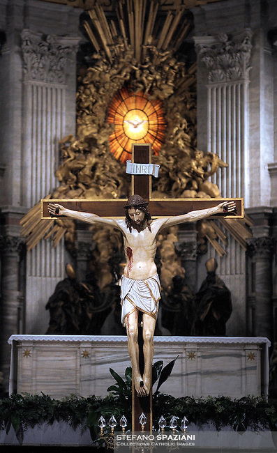 Crucifix Altar the of Saint Peter by Bernini,Vatican Basilica..The Cathedra Petri (Latin) or Chair of Saint Peter is a relic conserved in St. Peter's Basilica, Rome, enclosed in a gilt bronze casing that was designed by Gian Lorenzo Bernini and executed 1647-53..Above the throne in a stuccowork dorati radial surrounded by angels, is a finestrone of Fund in Alabaster depicting a dove (the wingspan is 162 cm), symbol (which, according to the Catholic doctrine, guide the successors of Peter in their job) Holy Spirit. It is the only stained glass colored the entire Basilica of Saint Peter..3-04-2009
