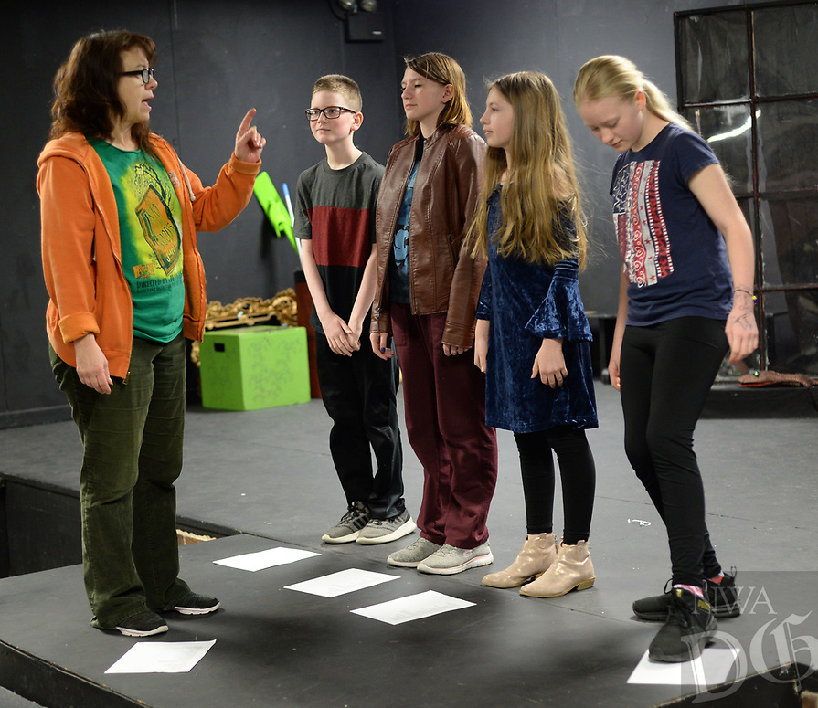 NWA Democrat-Gazette/ANDY SHUPE<br /> Jules Taylor (from left), a longtime performer and instructor, works Wednesday, March 20, 2019, with actors Ethan Fox, 11; Sophie Moody, 12; Haleigh Staley, 11; and Josie Riggins, 11, as they stage an original musical theater piece during Musical Theater Camp at Arts Live Theatre in Fayetteville. The longtime children's theater plans a performance of Junie B. Jones The Musical May 2-5 and will host summer theater camps during the summer.