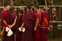 Buddhist  Lamas examing masks for the Losar dance, Kalimpon, India