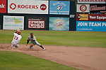 Tuesday, July 14, 2009.  Vancouver left fielder # 23 Rashun Dixon slides in to 2nd base for a double and no outs in the 6th inning. The Vancouver Canadians went on to win the game against The Boise Hawks 3-2 at Nat Bailey Stadium in Vancouver.   Photo by Gus Curtis.