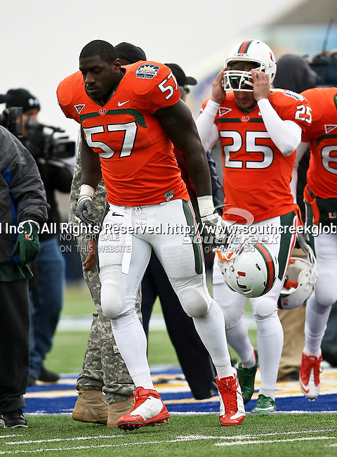 Miami Hurricanes defensive lineman Allen Bailey (57) participates in the coin toss before the 2010 Hyundai Sun Bowl football game between the Notre Dame Fighting Irish and the Miami Hurricanes at the Sun Bowl Stadium in El Paso, Tx. Notre Dame defeats Miami 33 to 17...