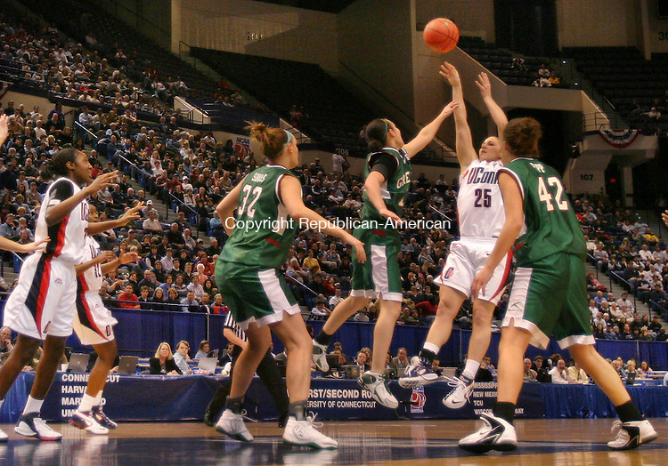 HARTFORD, CT. 20 March 2007-032007SV12--#25 Mel Thomas of UConn launches a shot from the top of the key as against Wisconsin Green Bay during the second round of NCAA action at the Civic Center in Hartford Tuesday.<br /> Steven Valenti Republican-American