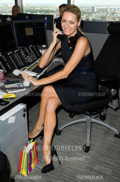 Tess Daly takes to the trading floor at BGC in Canary Wharf as part of the fundraising day set up after the 9/11 terrorist attacks. 12/09/2011 Picture by: Simon Burchell / Featureflash