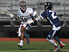Trevor Yeboah-Kodie #15 of Garden City, left, gets pressured by Jake Levitz #27 of Hewlett during a Nassau County varsity boys lacrosse game at Garden City High School on Wednesday, May 3, 2017. Garden City won 4-3 in double overtime.