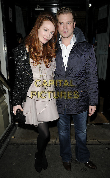"OLIVIA GRANT & GUEST.""The Best Of British Talent"" party, Bar Music Hall, Shoreditch, London, England..January 27th, 2010.full length black dress sequins sequined grey gray beige dress pearl necklace puffa jacket jeans denim tights black.CAP/CAN.©Can Nguyen/Capital Pictures."