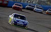 Nov. 9, 2008; Avondale, AZ, USA; NASCAR Sprint Cup Series driver Jimmie Johnson (48) leads the field during the Checker Auto Parts 500 at Phoenix International Raceway. Mandatory Credit: Mark J. Rebilas-