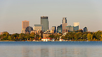 Minneapolis skyline and Lake Calhoun  late afternoon. Lake Calhoun is the biggest lake in Minneapolis, Minnesota, and part of the city's Chain of Lakes. Surrounded by city park land and circled by bike and walking trails, it is popular for many outdoor activities. The lake has an area of 401 acres (1.62 km2) and a maximum depth of 87 feet (27 m). The Twin Cities are the sixteenth-largest metropolitan area in the United States.