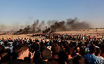 Palestinian protesters gather during clashes with Israeli troops in tents protest where Palestinians demand the right to return to their homeland at the Israel-Gaza border, in Rafah in the southern of Gaza Strip on September 21, 2018. Photo by Mahmoud Bassam