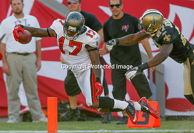 Tampa Bay Buccaneers wide receiver Arrelious Benn (17) scores the Buccaneers first touchdown as New Orleans Saints free safety Malcolm Jenkins (27) defends. The Buccaneers defeated the Saints 26-20 in an NFL game, Sunday, Oct. 16, 2011 in Tampa, Fla. (AP Photo/Margaret Bowles)