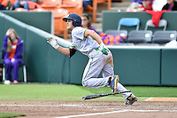Notre Dame Fighting Irish left fielder Jake Johnson (39) runs to first during a game against the Clemson Tigers during game one of a double headers at Doug Kingsmore Stadium March 14, 2015 in Clemson, South Carolina. The Tigers defeated the Fighting Irish 6-1. (Tony Farlow/Four Seam Images)