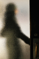 A woman silhouette opening a door