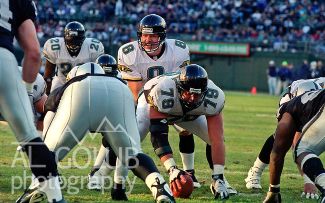 Oakland Raiders vs. Jacksonville Jaguars at Oakland Alameda County Coliseum Sunday, December 21, 1997.  Jaguars beat Raiders  20-9.  Jacksonville Jaguars quarterback Mark Brunell (8) over center Dave Widell (79).