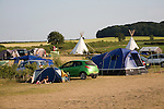 Campsite Indian tepees and tents at Deepdale Camping, Burnham Deepdale, Norfolk, England