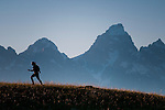 A young woman hikes below the Teton skyline in Jackson Hole, Wyoming.