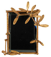 BNPS.co.uk (01202 558833)<br /> Pic: Juliens/BNPS<br /> <br /> Taylors Claude Lalanne vanity mirror - est £16,000.<br /> <br /> A spectacular collection of over 1,000 items charting Elizabeth Taylor's life including her iconic outfits are up for sale for over £1million. ($1.25million)<br /> <br /> Dozens of designer gowns, fur coats and capes are being auctioned by the trustees of the estate of the late English actress.<br /> <br /> Also going under the hammer are the Hollywood icon's stylish wigs, scarves, shoes and jewellery.<br /> <br /> Items of her lavish furniture from her luxury homes across the world, right down to her personalised salt and pepper shaker, are included.