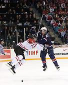Marco Scandella (Canada - 5), Kyle Palmieri (USA - 23) - Team Canada defeated Team USA 5-4 (SO) on Thursday, December 31, 2009, at the Credit Union Centre in Saskatoon, Saskatchewan, during the 2010 World Juniors tournament.