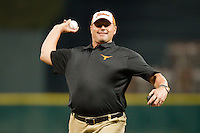 Former Texas Longhorn and Major League Baseball pitcher Roger Clemens throws out the ceremonial first pitch prior to the game between the Rice Owls and the Texas Longhorns at Minute Maid Park on February 28, 2014 in Houston, Texas.  The Longhorns defeated the Owls 2-0.  (Brian Westerholt/Four Seam Images)