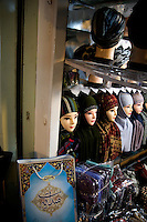Stores display Muslim and Uighur women's scarves in a market in the Uighur section of Urumqi, Xinjiang, China.