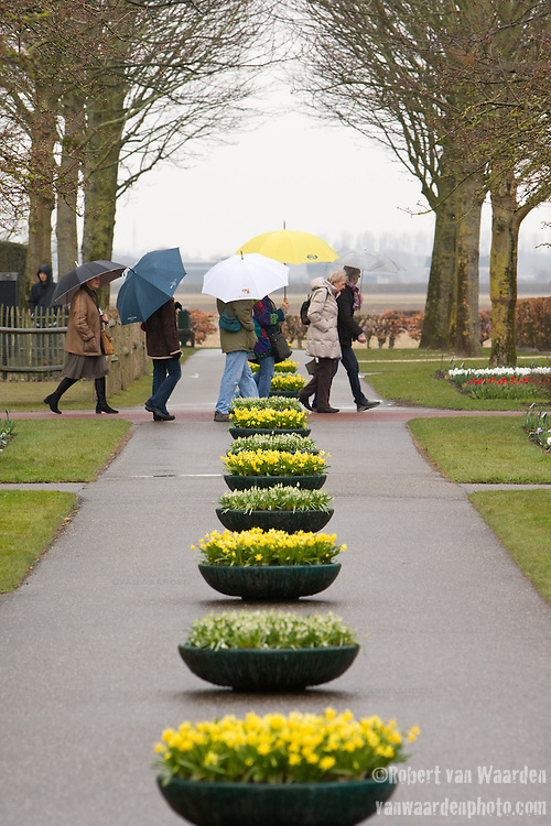 A group of tourists in the rain at the Keukenhof in Amsterdam.