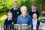 Author Eoin Cotter gave a talk and a reading to the children of St Joesphs NS Castlemaine with Brendan Griffin TD in Killoclohane Woods on Wednesday morning with Megan Flynn, Ben Downes, Jamie Sparton and Kaya Somers