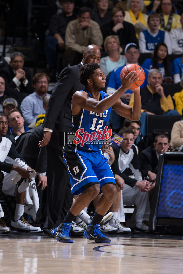 Justise Winslow (12) of the Duke Blue Devils attempts a jump shot during first half action against the Wake Forest Demon Deacons at the LJVM Coliseum on January 7, 2015 in Winston-Salem, North Carolina.  The Blue Devils defeated the Demon Deacons 73-65.  (Brian Westerholt/Sports On Film)